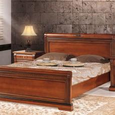 Νεοκλασική κάμαρα με χαρακτηριστικό την οβάλ λεπτομέρεια στο κρεβάτι και στα συρτάρια.